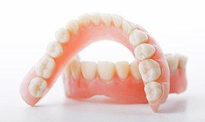 Съемные зубные протезы цена